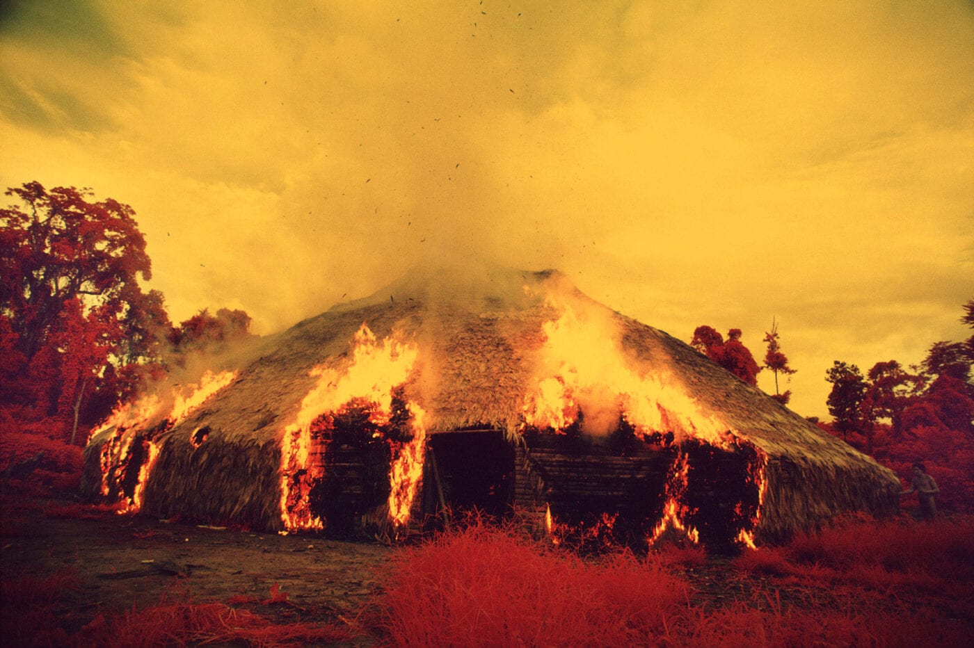 The Yanomami often burn down their yano [collective house] when they migrate, when they want to escape from an epidemic, or when an important leader dies. Catrimani, 1972-76. Infrared film. © Claudia Andujar